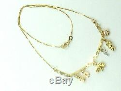 14K two tone gold seven dangle charms necklace heart bar. 17 1/4.5.9gm
